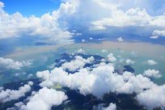 clouds ön över Arkivbild