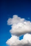 Clouds. White fluffy clouds against bright blue sky Stock Image