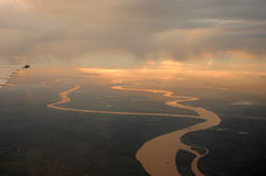 Clouds 14. The Lujan river reflecting the sun light from a plane Royalty Free Stock Photos