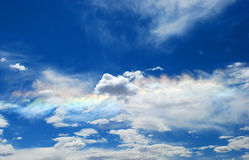 Clouds. Several clouds in the sky with a rainbow Stock Photos