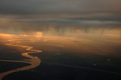 Clouds 16. The Lujan river reflecting the sun light from a plane stock photo