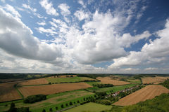 Clouds. Over patchwork fields in England Stock Images