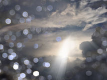 Clouds. Light beams through Clouds with Bokeh Royalty Free Stock Photography