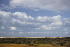 Clouds. Above the dunes in Holland royalty free stock photo