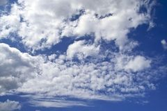 Clouds. White clouds over bright blue sky Royalty Free Stock Photo