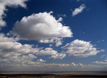 Clouds. Large Cumulus clouds passing over a Summer landscape Stock Photography
