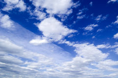 The clouds. The beautiful white clouds on background blue sky Royalty Free Stock Photos