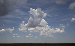 Clouds. In a blue sky over a Kansas landscape stock images