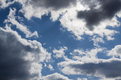 Clouds. Blue sky and sun beyond the clouds Stock Photos