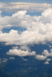 Clouds. The sky and white clouds seen from airplane window Royalty Free Stock Image