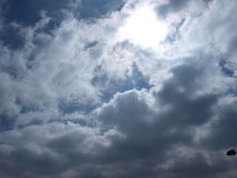 Clouds. Blue skies and sunshine behind the clouds royalty free stock photography