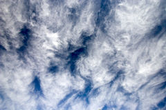 Clouds. White fluffy clouds against a blue sky stock photo