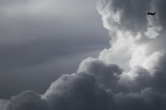 Clouds. Plane flying high above the storm clouds Stock Photography