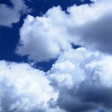 Clouds. Blue sky with fluffy storm clouds Stock Image