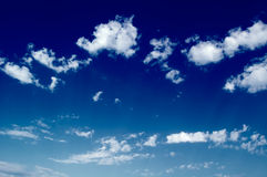 The clouds. White clouds in the blue sky. Cloudscape Stock Photos