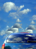 Clouds. Blue sky and clouds reflected in the car