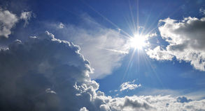 Clouds. Sun surrounded by fluffy clouds Stock Photos