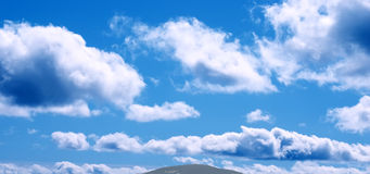 Clouds. Lots of small clouds in blue sky stock photography