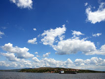 Clouds. Over grande river Dunav and harbour in Serbia royalty free stock images
