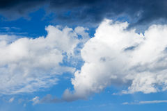 Clouds. On bright blue sky Stock Photos