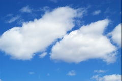 Clouds. Big fluffy white clouds stock photos