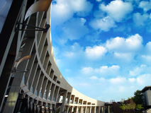 Clouds. Amazing clouds with a modern building Stock Image