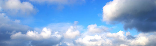 Clouds. White clouds over bright blue sky Stock Photography