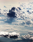 Clouds from above, altocumulus, meteorology. An overall view of some altocumulus, with a bright blue sky on the background, portrait cut Stock Images