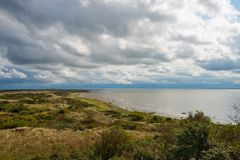 Clouds above the area Oerd of the island Ameland. Dramatic clouds above the area Oerd of the island Ameland, the Netherlands stock photo