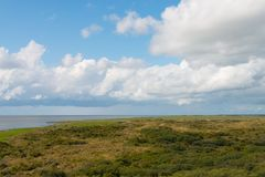 Clouds above the area Oerd of the island Ameland. The Netherlands royalty free stock photo