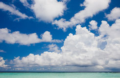 Clouds above the beach in the Indian Ocean Stock Photos