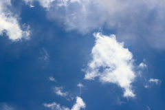 Clouds above blue sky Stock Images