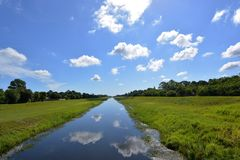 Clouds Above Canal Royalty Free Stock Photo