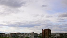 Clouds above city skyline. Clouds moving over blue sky. HD Time lapse