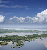 Clouds above the flooded plain Royalty Free Stock Photo