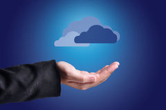 Clouds Above Hands. Cloud Computing Concept. Royalty Free Stock Images