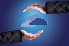 Clouds Above Hands. Cloud Computing Concept. Stock Photos