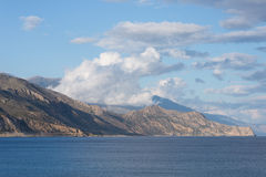 Clouds above the Lefka Ori mountains on Crete Stock Image
