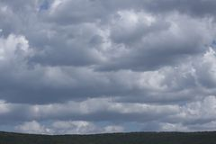 Clouds above the mountain. Cloudy skies over the hills of Ammoudia, Greece Stock Photography