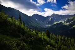 Clouds above the mountain valley. Landscape background Clouds above the mountain valley Stock Image