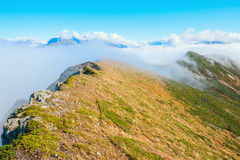 Clouds above and between the mountains. Stock Photos