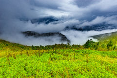 Clouds above and between the mountains. Royalty Free Stock Photography