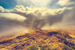 Clouds above and between the mountains. Stock Images