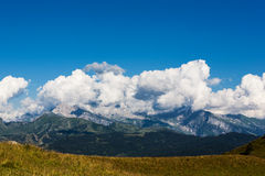 Clouds above mountains Royalty Free Stock Image