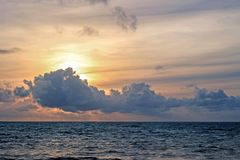clouds above ocean at sunset Royalty Free Stock Photo