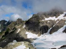 Clouds above Queest-alb Glacier, Washington state. Royalty Free Stock Photography