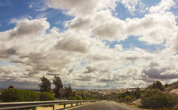 Clouds above road Stock Photography