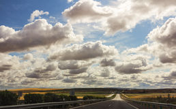Clouds above road Stock Images