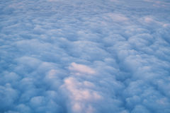Clouds from above. Sky and clouds image taken form above while flying in a plane Royalty Free Stock Image