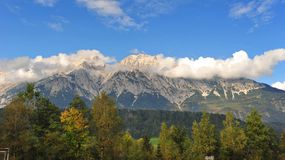 Clouds above snow capped mountains in Austria Stock Photography